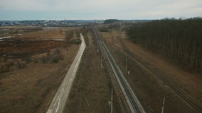 Aerial view: rural landscape, fields, track, high-voltage network in Ukraine stock video footage