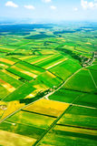 Aerial view of rural landscape under blue sky. Aerial view of green rural landscape under blue sky Royalty Free Stock Photo