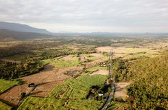 Aerial view of Agricultural plots. Aerial view of rural villages in northeastern Thailand, with Agricultural plots mountains and cloudy skies Stock Photo