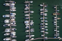 Aerial view of sail boats docked in a Marina in Portimao, Algarve. Concept for travel in Portugal and luxury summer vacations royalty free stock photography