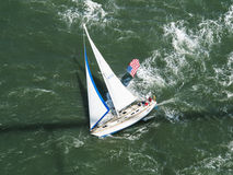 Aerial view of sailboat racing along Stock Images