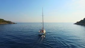 Aerial view of sailing boat going out to sea. stock video