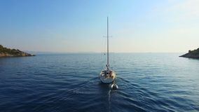 Aerial view of sailing boat going out to sea. stock footage