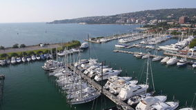 Aerial: view of sailing boats docked in harbor stock video