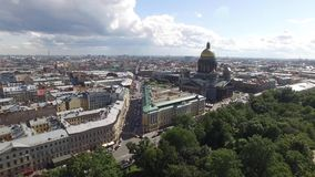 Aerial view of Saint Isaac`s Cathedral an downtown of St.Petersburg Russia. Golden domes. Angels. Dramatic sky. Close approach stock video footage