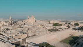 Aerial view of Saint Paul Cathedral dome in Mdina old town, Malta touristic emblem in ancient town with old buildings. Aerial view of Saint Paul Cathedral dome stock footage