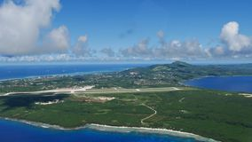 Aerial view of Saipan with the International Airport in view. Aerial view of Saipan coastlines approaching from Tinian with the Saipan International Airport in Stock Image