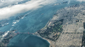 Aerial View of San Francisco and Golden Gate Bridge. The Famous Golden Gate Bridge and part of San Francisco as  seen from an aircraft window Royalty Free Stock Photos