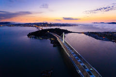 Aerial view of San Francisco Oakland Bay Bridge at sunset Stock Photo