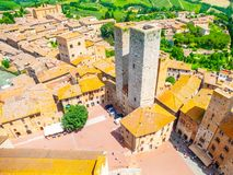 Aerial view of San Gimignano historical city centre with twin towers - Torri dei Salvucci, Tuscany, Italy Royalty Free Stock Photo