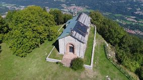 Aerial view of San Martino Church, is situated on top of San Martino Mount at Duno, province of Varese. stock footage