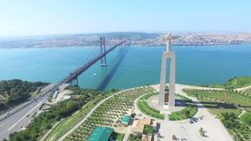 Aerial view of Sanctuary of Christ the King overlooking Lisbon stock footage