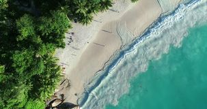 Aerial view of sand beach. Looping ocean texture, Top view sea waves slow motion, flying over tropical sandy beach and waves. Sea waves on the beautiful island stock video footage