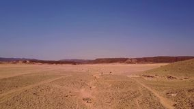 Aerial view of the sand dunes and mountain. stock footage