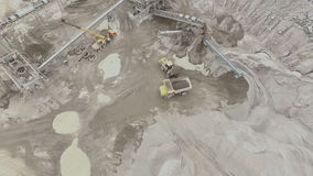 Aerial view of a sandstone quarry with processing lines. Aerial view of a sandstone quarry with the processing lines, dump trucks and excavators. excavator pours stock video