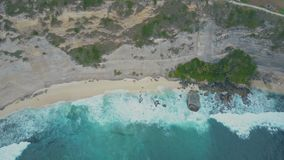 Aerial view of sandy beach with beautiful waves, turquoise ocean water, palms. Aerial view of sandy beach with beautiful waves, turquoise ocean water, palm trees stock video