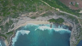 Aerial view of sandy beach with beautiful waves, turquoise ocean water, palms. Aerial view of sandy beach with beautiful waves, turquoise ocean water, palm trees stock video footage