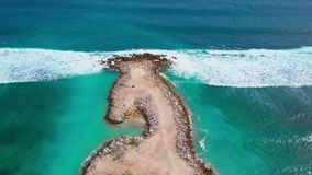 Aerial view of sandy beach with beautiful white waves, turquoise ocean water. Aerial view of part sandy beach with beautiful white waves, turquoise ocean water stock video