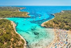 Aerial view of sandy beach, blue sea, people and yachts Stock Image
