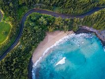 Aerial view of the sandy beach. And curved asphalt road on the west coast of Maui. Hawaii stock photography
