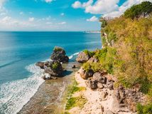 Aerial view of sandy beach with ocean and rocks at Padang Padang, Bali. Stock Image