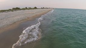 Aerial view sandy beach of the sea at the evening stock video footage