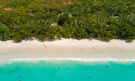 Aerial view of sandy beach with tourists swimming in beautiful clear sea water.  royalty free stock photography