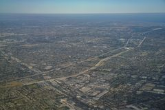 Aerial view of Santa Fe Springs, Norwalkm Bellflower, Downey, vi. Ew from window seat in an airplane, California, U.S.A Royalty Free Stock Photography