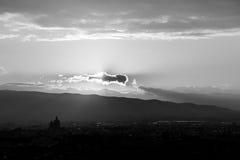 An aerial view of Santa Maria degli Angeli church Assisi at su. Nset, with the sun hidden behind a cloud Stock Photo