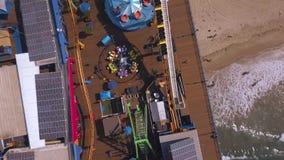 Aerial view of the Santa Monica pier amusement park near Venice beach.