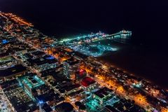 Aerial view of the Santa Monica shoreline at night. Aerial view of the Santa Monica shoreline, amusment park and pier at night Royalty Free Stock Photos