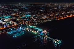 Aerial view of the Santa Monica shoreline at night. Aerial view of the Santa Monica shoreline, amusment park and pier at night Stock Images
