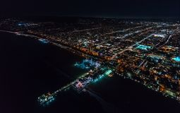 Aerial view of the Santa Monica shoreline at night. Aerial view of the Santa Monica shoreline, amusment park and pier at night Stock Photography
