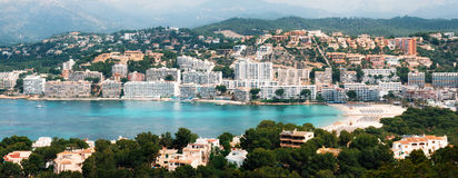 Aerial view of Santa Ponsa resort and the beach, Mallorca. Beautiful panoramic view from above of Santa Ponsa resort, the beach with white sand, sunbeds, hotels Stock Photography