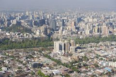 Aerial view of the Santiago city with the blue smog from the San Cristobal Hill, Santiago, Chile. Royalty Free Stock Photography