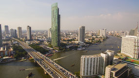 Aerial view of sathorn bridge crossing chao praya river in heart Royalty Free Stock Photos