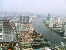 Aerial view of Sathorn Unique Tower, Wat Yannawa, The Chao Phraya Bank in Bangkok city, Thailand, Asia. Aerial panoramic generic view of the landmarks Sathorn royalty free stock photos
