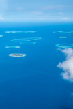 Aerial view of scattered islands, maldives Royalty Free Stock Photos