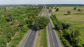 Aerial view scenic landscape of countryside highway traffic with a car and truck on the road, Drone shot stock video