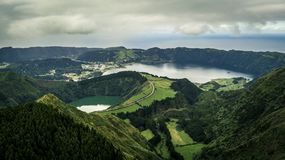 Aerial view on scenic landscape of volcanic lake Sete Cidades. Aerial view on scenic landscape of volcanic lake Sete Cidades and green fields around it. Special Royalty Free Stock Photography