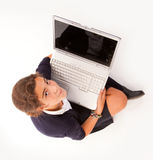 Aerial view of schoolgirl with laptop Stock Photos