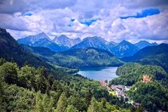 Aerial view of Schwangau, Germany under dark brooding sky. Aerial view of Schwangau with Alpsee in the background under a dark brooding sky Royalty Free Stock Image