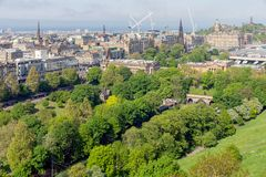 Aerial view from Scottish Edinburgh castle at Princes Street gardens. And Waverley railway station. In the background Calton Hill royalty free stock image