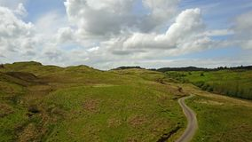 Aerial view of the scottish highlands with single track road and sheep. Between Oban and Taynuilt, Argyll, Scotland stock footage