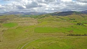 Aerial view of the scottish highlands with single track road and sheep. Between Oban and Taynuilt, Argyll, Scotland stock video footage