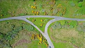 Aerial view of the scottish highlands with single track road and turnout junction. Aerial view of the scottish highlands with single track road with turnout stock video footage