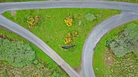 Aerial view of the scottish highlands with single track road and turnout junction. Aerial view of the scottish highlands with single track road with turnout stock footage