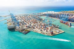 Aerial view of the sea cargo port with a huge number of containers, cranes for unloading goods. Large ship at the pier at. Unloading. Maritime transport concept royalty free stock photography