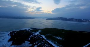 Aerial view of sea at dusk 4k. Aerial view of beautiful sea at dusk 4k stock video