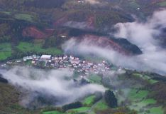 Aerial view,Sea of fog coverage the mountains forest in the morning in Betelu. Navarra Stock Image